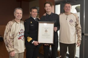 ET2016-0075-02 Rear Admiral (RAdm) Gilles Couturier, Commander of Maritime Forces Pacific/Joint Task Force (Pacific) (MARPAC/JTF(P)), presents Ty Gretzky with the MARPAC Bravo Zulu at the Heroes Hockey Challenge Pre-game Luncheon held at Canadian Forces Base (CFB) Esquimalt Wardroom on 6 March 2016, with Lieutenant General (Retired) (LGen (Ret'd) Kent Foster and Vancouver Canucks Alumni Darcy Rota present. Image by LS Ogle Henry, MARPAC Imaging Services