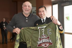 ET2016-0075-03 Rear Admiral (RAdm) Gilles Couturier, Commander of Maritime Forces Pacific/Joint Task Force (Pacific) (MARPAC/JTF(P)), is presented with his hockey jersey by Vancouver Canuck Alumni Dave 'Tiger' Williams at the Heroes Hockey Challenge Pre-game Luncheon held at Canadian Forces Base (CFB) Esquimalt Wardroom on 6 March 2016. Image by LS Ogle Henry, MARPAC Imaging Services