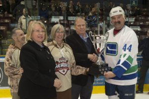 ET2016-0076-04 The Honourable Judith Guichon, Lieutenant Governor of British Columbia, along with Silver Cross Parents Jane and Richard Nuttal, presents the Heroes Hockey Challenge Cup to Vancouver Canucks Alumni Captain Dave Babych at the conclusion of the hockey game between the Alumni and the Heroes Hockey Challenge (HHC) Warriors (CAF Members) held at the Q Centre, Colwood, British Columbia, on 6 March 2016. Image by LS Ogle Henry, MARPAC Imaging Services